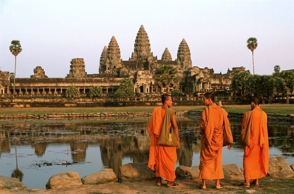 Monks prepare to watch the sunset at the main temple of Angkor Wat.