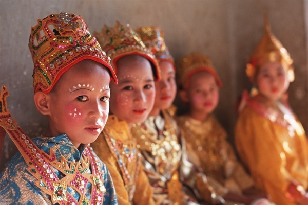 Young boys in traditional costume during a coming of age ceremony.