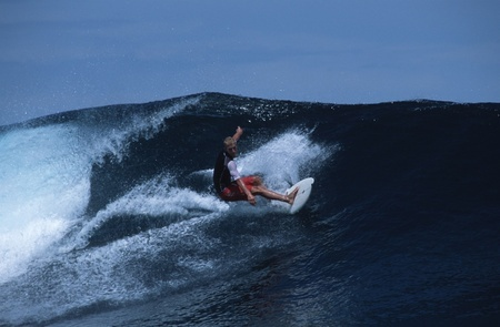 """Catch a wave and you're flying on top of the world. A surfer pulls off a stunt while on a boat-charter surf holiday in one of the world's most recently discovered surf heavens, the Mentawai Islands of Indonesia. Despite spending two weeks in some of the prettiest tropical islands in Indonesia, apart from riding the waves these holiday-makers pretty much stay on their boat for fear of contracting malaria, dengue fever, TB and a host of other infectious diseases. """"If you are a surfer, this is quite simply paradise."""" said an American surfer named Owen who says he has surfed all over the world. """"In Malibu there are thousands of surfers in the water, four of five people on every wave. In the Mentawais, it's yours all yours. It's your ten days of fame and if you go back with all your boards intact you did not have a good time!"""""""