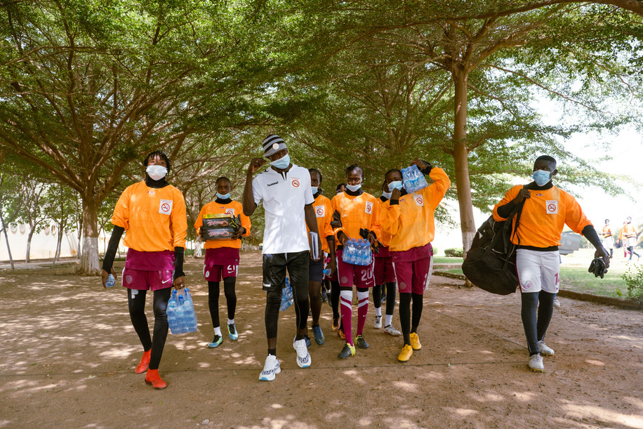 """In Senegal, 9.2% of students aged 13–15 use tobacco, according to the 2020 Global Youth Tobacco Survey findings of the World Health Organization (WHO) and Africa Centres for Disease Control and Prevention.<br><br>Senegal is considered one of the most advanced African countries in the fight against tobacco use. A 2016 law forbids tobacco advertising and the sale of tobacco products within 200 metres of schools, stadiums, health facilities and cultural facilities.<br><br>Lamine Thiare, a well-known goalkeeper in Senegal and across West Africa, always reminds the young players he coaches about the dangers of tobacco. """"If you want to have a long career in sport, do not smoke!"""", he tells young players again and again. At 40, Thiare coaches teenagers at the Diambars Institute, a prestigious sport and education academy in Saly, roughly 70km south of the capital city Dakar, as well as the goalkeepers for the women's national A team. He also set up his own institution: the Nkono keepers Academy.<br><br>Lamine Thiare and members of the team walk to the field to practice.<br><br>Read more <a target="""